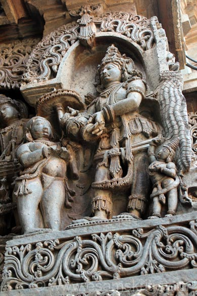 Left side of pic. Lord Vishnu takes the form of Vamana or Dwarf and asks demon Bali for three feet gift of land. Right of pic small image at bottom is Shukracharya who tells Bali not to gift but the demon does not listen. To see earlier pictures of temple please click on Halebidu Temples.