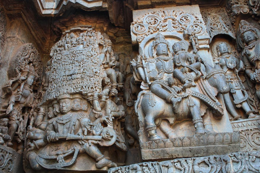 Left is Ravana lifting Mount Kailasha ie the abode of Lord Shiva. Right is Shiva and Parvati on an elephant.