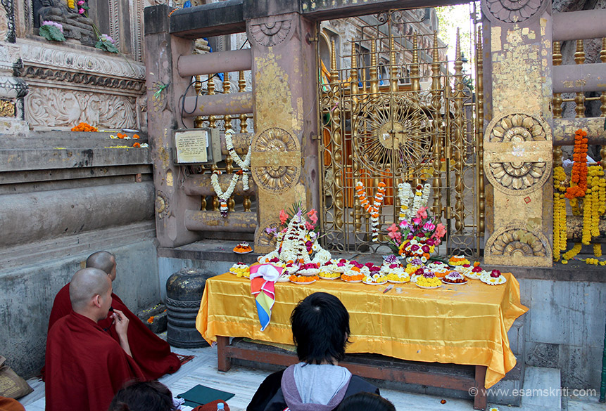"Behind you see the Vajrasana or Diamond Throne and a gate to enter that area. Large number of devotees pray and meditate in this area as well. ""Bodhgaya Temple was in the hands of its 