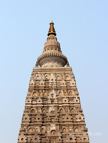 "A close up of the top portion of the 50 feet pyramidal tower crowned with a bell like stupa whose close up you shall see later. ""In due course this Mahavira was occupied by the Mahant and he
