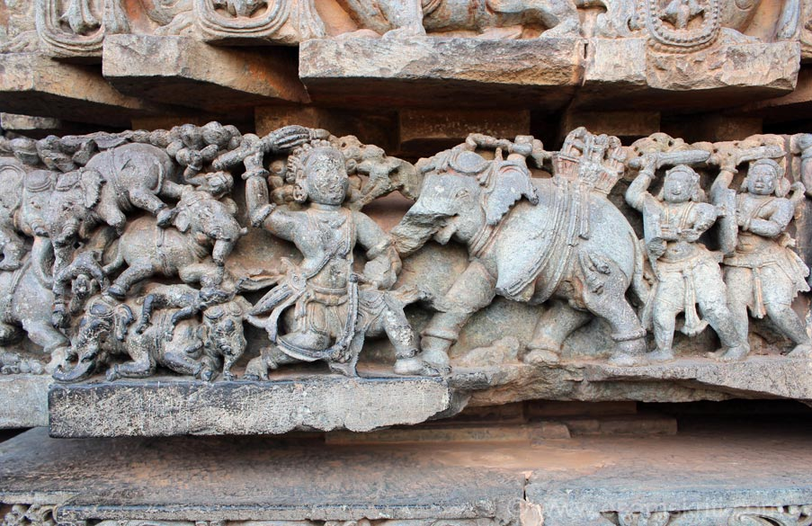 Scene from Mahabharata. U see Bhima in centre of pic with elephant attacking him. He kills the elephant and throws them behind his back as u can see on left of pic.