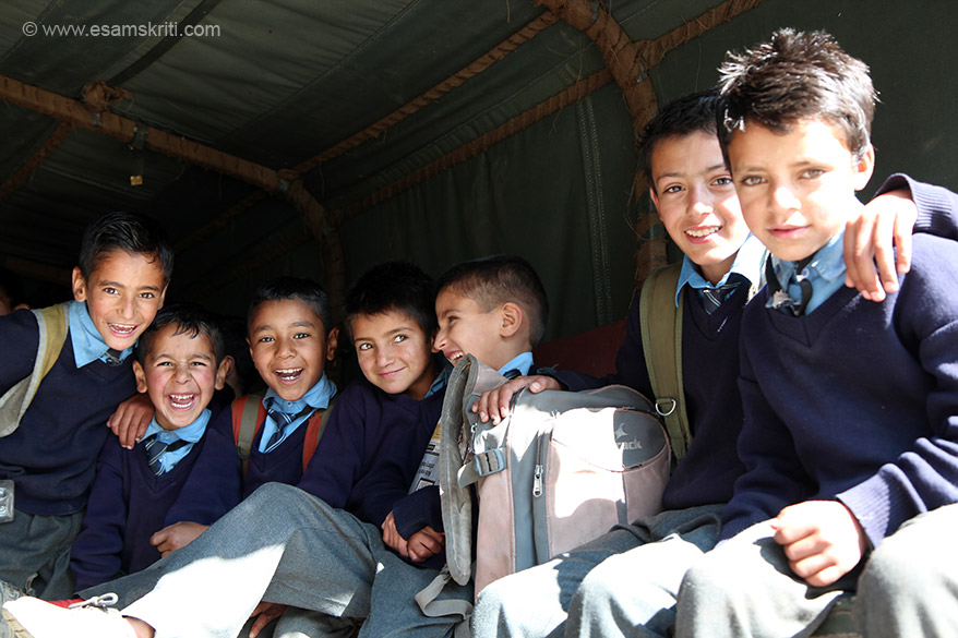 Close up of boys in school bus. All smiles and very happy to be photographed. As of August 2016, the Army runs 46 schools in J&K of which 8 each are in Jammu and Ladakh regions and 30 in Kashmir Valley.