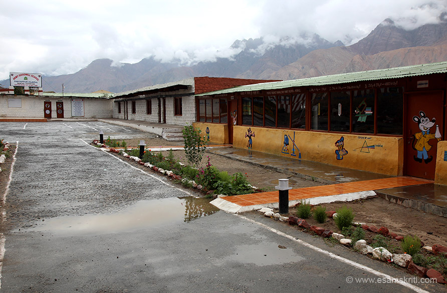 "This is Army Goodwill School at Partapur in Nubra Valley set up in 1998. It had just rained hence water. We visited on Sunday afternoon so could not see school from inside. To see pics of UMANG, a very women cooperative near Raniket  <a href=""http://www.esamskriti.com/photo-detail/UMANG-Raniket.aspx"" target=""_blank"">Click here</a>"