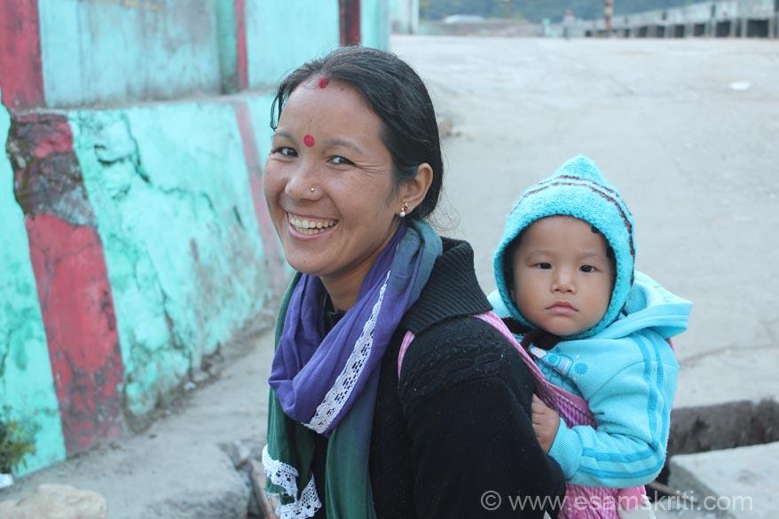 A Nepali lady with her baby. Pic taken around 8 am. Nepalis run many restaurants on the Indian side of Dharchula. The Indo Nepal Friendship Treaty of 1950 allows that.