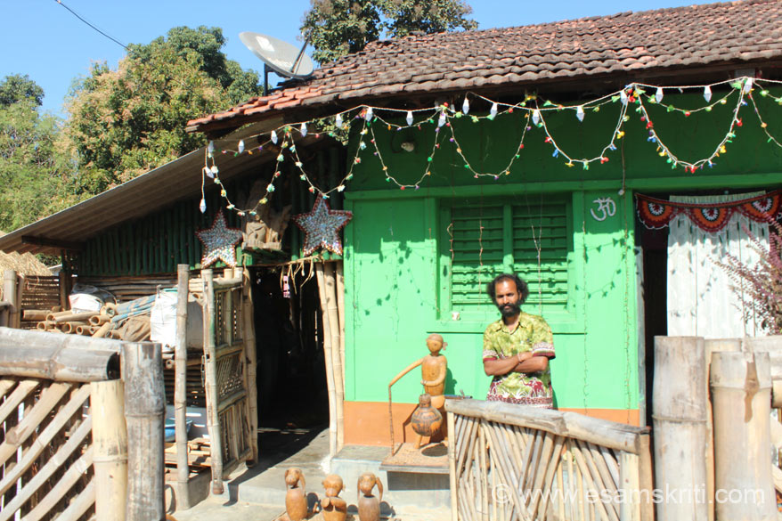 Jagat Ram outside his house cum workshop. Right where u see curtain is his bedroom. Left centre the open cane door is his workshop. He also has a DISH TV connection. Found many