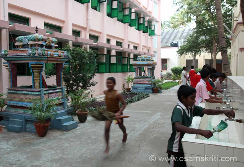 Child running with broom. What I liked about this school was very clean and kept that way by the students.