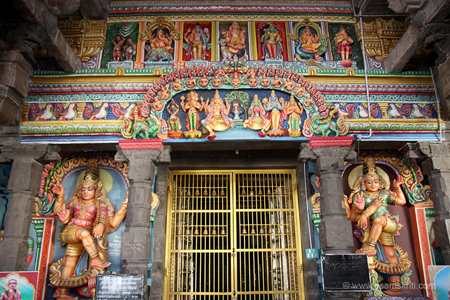 "Entrance to sanctum. Dwarpals (doorkeepers) on either side. ""This is One of 275 Siva Devara Sthalam. The temple is One of Saptha Vidanga Sthalam."""