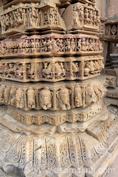 A close up of lower portion of pillar. Row one is elephant, two is warriors on horse, three dancers. Row 4 seems like men with arrow etc but most images damaged.