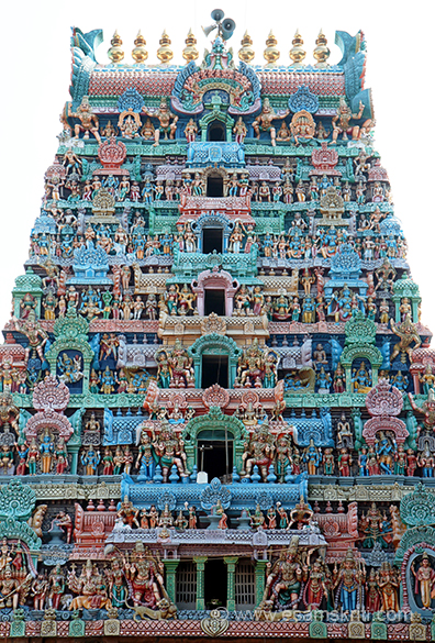 "Rear side view of gopuram. ""It is note worthy that devout Saivite Saint Appar – Tirunavukkarasar worshipped here and had the Mount Kailash darshan from here.  He had his holy bath in the Manasa Sarovar at Kailash and returned from the Tiruvaiyaru tank.  This Surya Pushkarini Theertha is all sacred. """