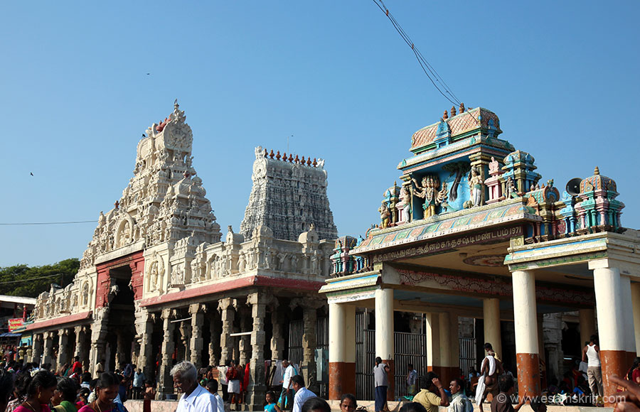 Shanmukha Vilasa (gopuram on left) is the frontal adjunct to the main temple. It is a magnificent mandapa worked minutely of intricate stone plinths and columns 120 feet long, 86 feet broad and supported by 124 columns. It runs north to south facing the sea. A colossal porch at the centre is 48 feet square. It houses an ornate mandapa of four pillars, on a fifteen feet square base and which is elevated by three feet.""