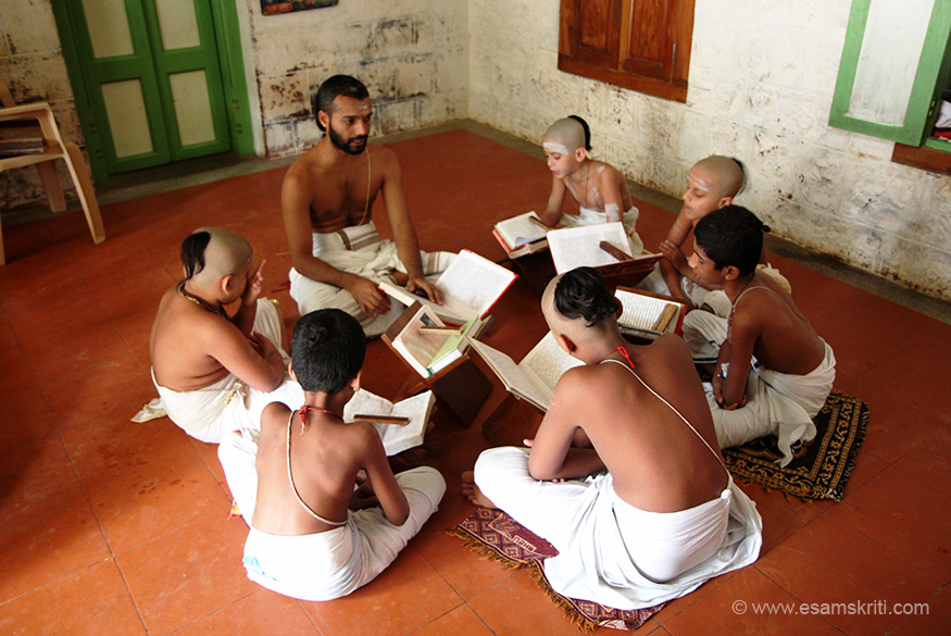 "Inside the ashram is a Vedapatasala. Students at work. To visit the Ashram website <a href=""http://www.sriramanamaharshi.org/ashram/