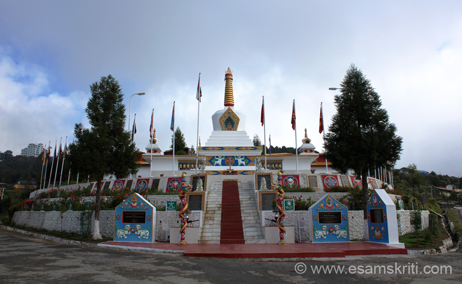 An overview of the Tawang War Memorial. Pic taken about 6.30 am. Weather in Tawang changes very fast from foggy to sunny. Flags that you see represent the regiments who fought during the Indo China War of 1962. Memorial made per Buddhist tradition as you shall read later.