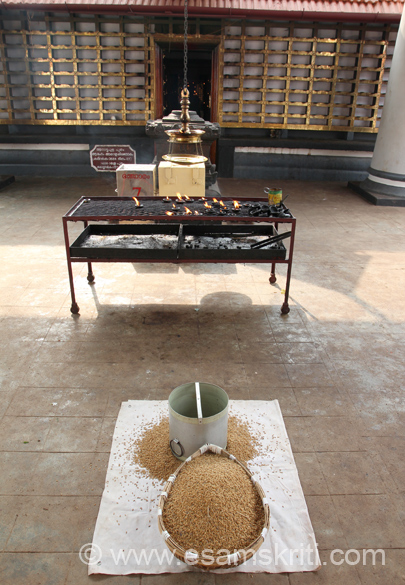 In front the vessel is called PARA. In it is rice with husk. It is made of cane and a traditional measure of offering to the Deity.