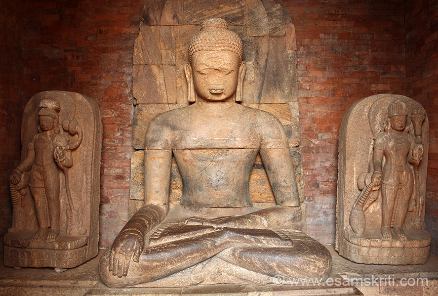 Inside shrine is a large seated Khondalite Buddha image (in a rare bhoomisparsa posture) together with other Buddhist divinities.