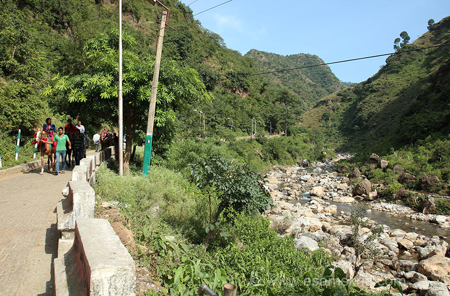 It is about a one hour trek, at times does get steep. There are horses, rate is fixed. What I did was to walk for nearly 40 minutes and took a horse where the climb got steep. Road is well paved and very clean. A stream flows as we walked, very green.