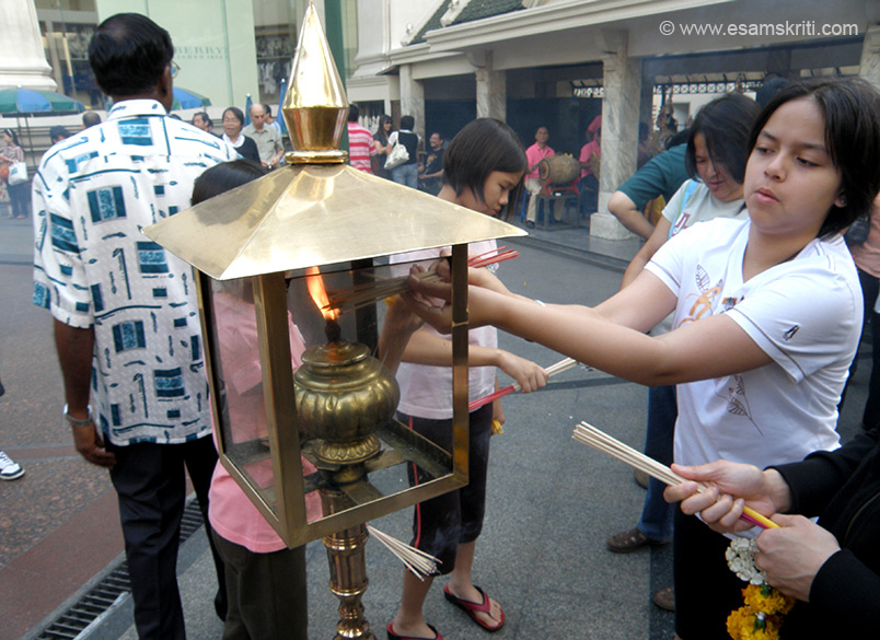 Thais burn incenses like this and then pray to Brahma as you shall be in the next picture.