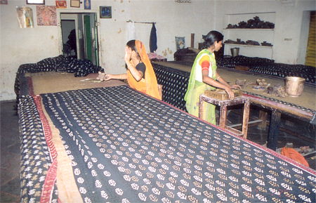This is unit number 2, a smaller unit where Manoj, his wife & sister did all the work. The women did the printing & Manoj the manual work. Here the women are printing a Salwar kameez ka thann.