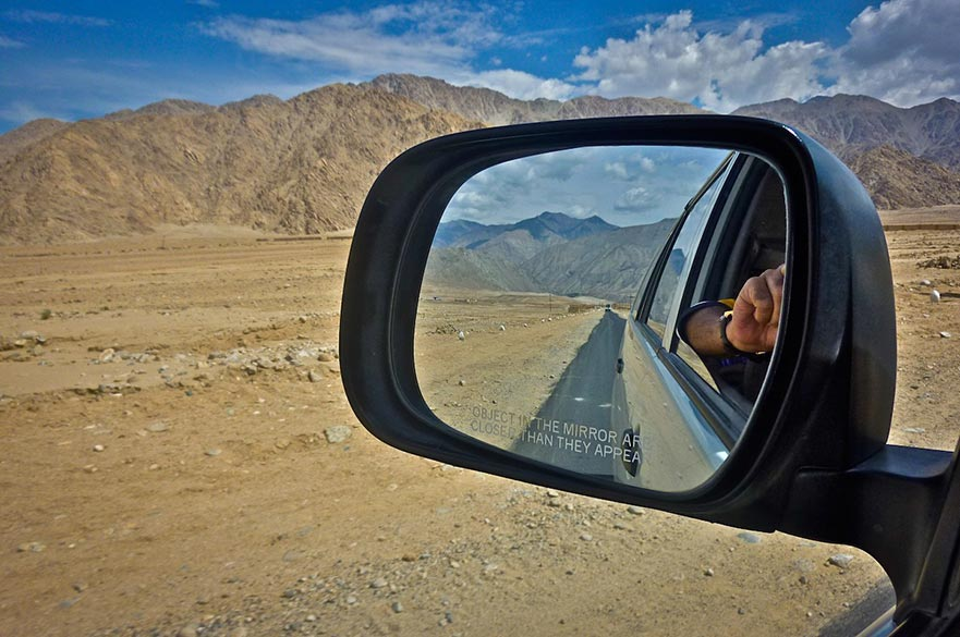 Objects in the Mirror: The omnipresent message 'Objects in the mirror are closer than they appear' on the rear view mirror of cars seems to be a little out of context as one drives on endless, long roads through the Ladakh region where often for miles and miles one sees no signs of life. Border Roads Organisation keeps the travelers in good humour through witty (and sometimes corny) messages aimed at keeping the drivers' attention on the road such as 'Feel my curves, but do not test them'.