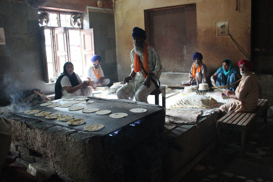 A smaller group making chapatis. Also a number of Karnatka temples serve food in leaves so no need to wash plates.