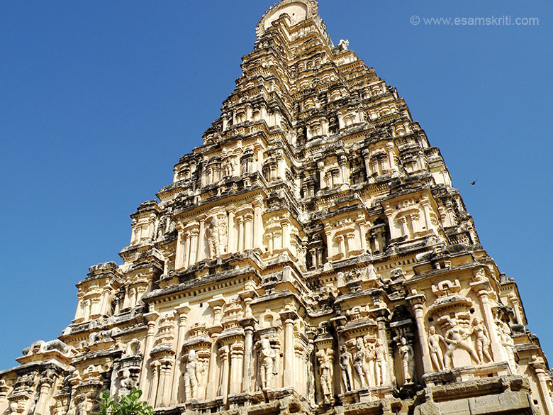 A close up view of the main gopuram of the Virupaksha Temple. Some of the images are mithuna couples. Virupaksha temple is also known as Pampapati temple or the temple of Lord of Pampa.