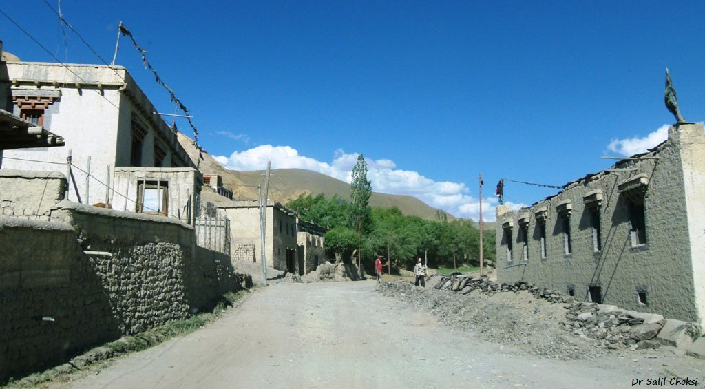 Mulbekh, the first Buddhist town on the Srinagar Leh Highway. Note the Buddhist prayer flags stung across roof tops .