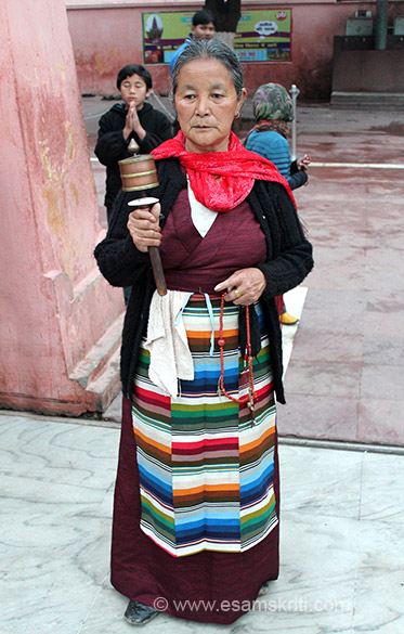 Sikkimese lady holding a hand prayer wheel. These are similar to the drum prayerwheels as they contain the mantra inside written on a roll of paper but they can can be held in the hand and 