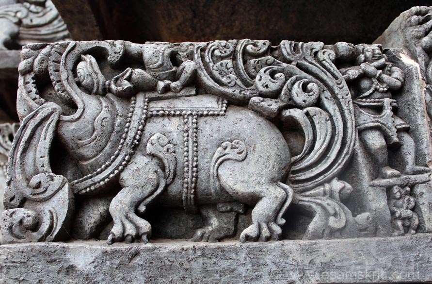 Close up of mythical animal Makara. Has body of pig, mouth of crocodile, trunk of elephant, feathers of peacock, legs of lion, eyes of monkey and cows ears.