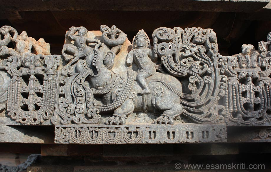 Varuna sits of mythical animal Makara. Left of pic is Kirtimukha to ward off evil.