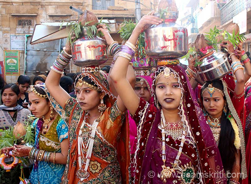 "This pic is of Jaisalmer Desert Festival 2013. Here you see pics of girls with steel and not copper pot. Like the ladies in Pandharpur the pot has a coconut and tulsi leaves. It is common symbols of Indian culture that bind the nation and help people overlook superficial differences. To see pics of Jaisalmer Desert Festival <a href=""http://www.esamskriti.com/photo-detail/People-of-Marwar.aspx"" target=""_blank"">Click here</a>"