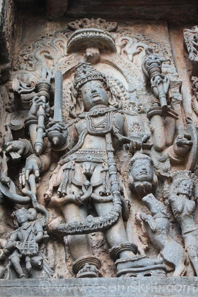 U see Lord Shiva holding demon head in his hand with Ganas (skeletons). See right of pic. Blood is flowing from the skeleton and a dog is waiting to drink the blood.