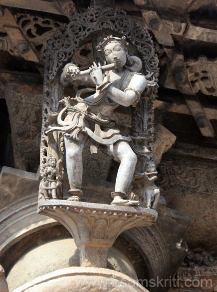Lady playing the flute.