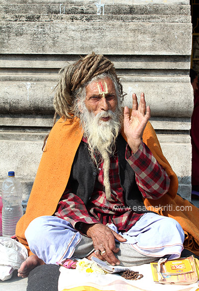 This Sadhu was sitting outside the shrine where Buddha spent week two after enlightenment ie Animesha Lochana.