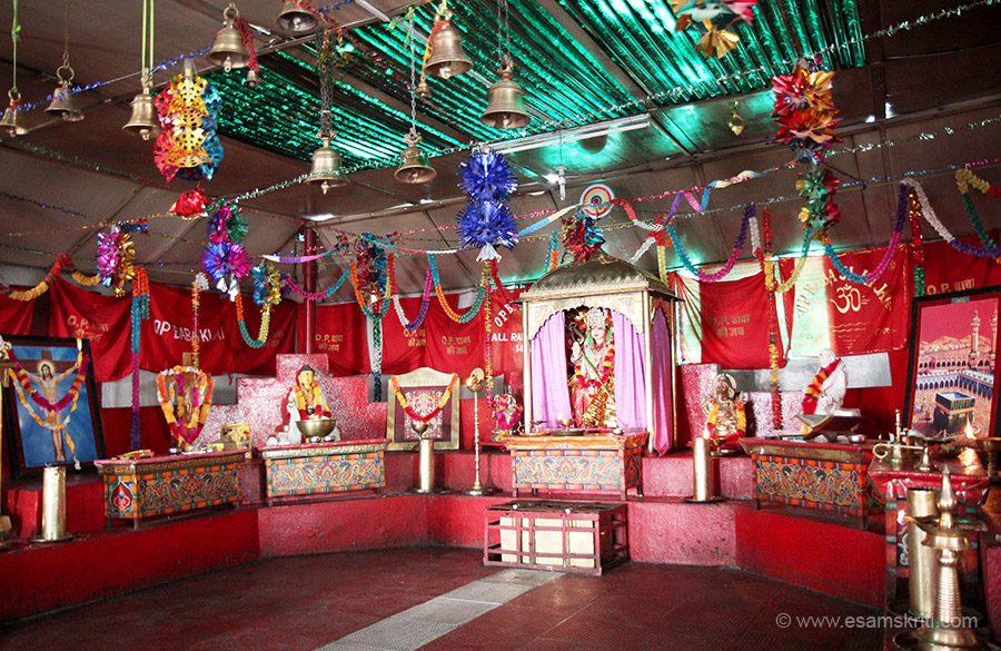 Room inside shrine. In centre is Mother Goddess, right of pic is Mecca, left is Jesus, Buddha and Ganesha too. Can you think of any army in the world that offers respect to all Gods that too