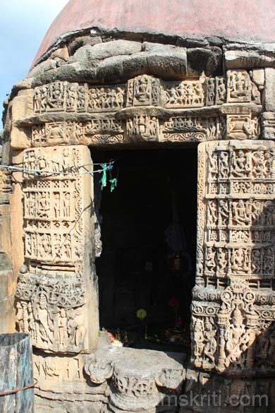 Entrance to temple with a brick colored dome. It is believed that Lord Vishnu assumed the tortoise incarnation (Kum Avatar) and penance for several hundred years on a mountain in