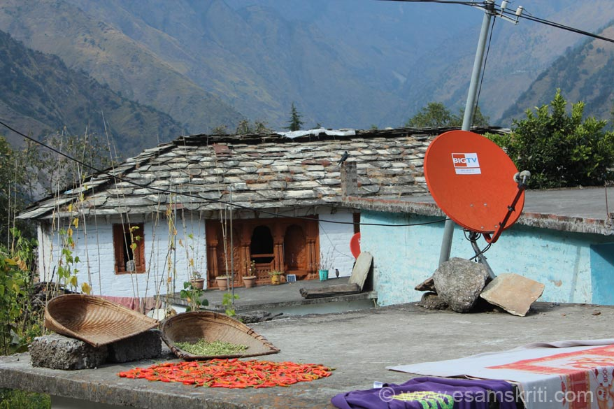 Virtually every house has a Dish Antennae mostly Tata Sky. In this pic u see a dish, village home and chillies being dried. All co exist. Found people very happy and content. Home