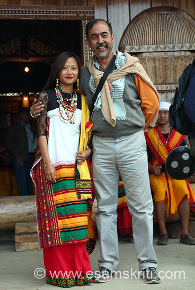 You see me with Kachari tribe girl. Note how colorful her dress is. Folk drama is called Nana Dibhonba. Indigenous game is called Rimin Nelaiba. Folk song is Slemah Dikhawbani.