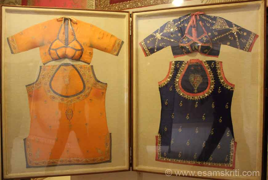 """Traditional royal costume wore by Maharanies of time in Rajasthan. Full costume is known as """"Poshak"""". This is just the upper part of the costume in pic, the upper one is called """"kanchali"""" and the below one is known as kurti. The Embroidered work done on them is using real gold and silver thread. This is traditonal attire of Rajasthani ladies."""