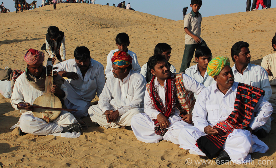 Local musicians - note the dress and comfort which they on the sand. Many might worry whether clothes will get dirty but these people in white could not be bothered.
