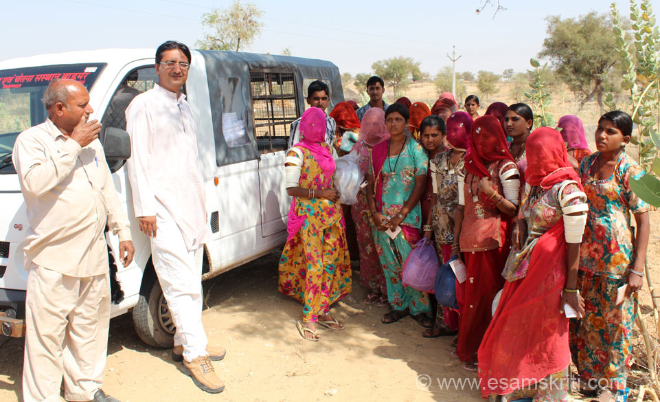 This Van goes from village to village giving material to ladies and collects finished product from them. The Accountant travels along. This way homemakers in villagers do 