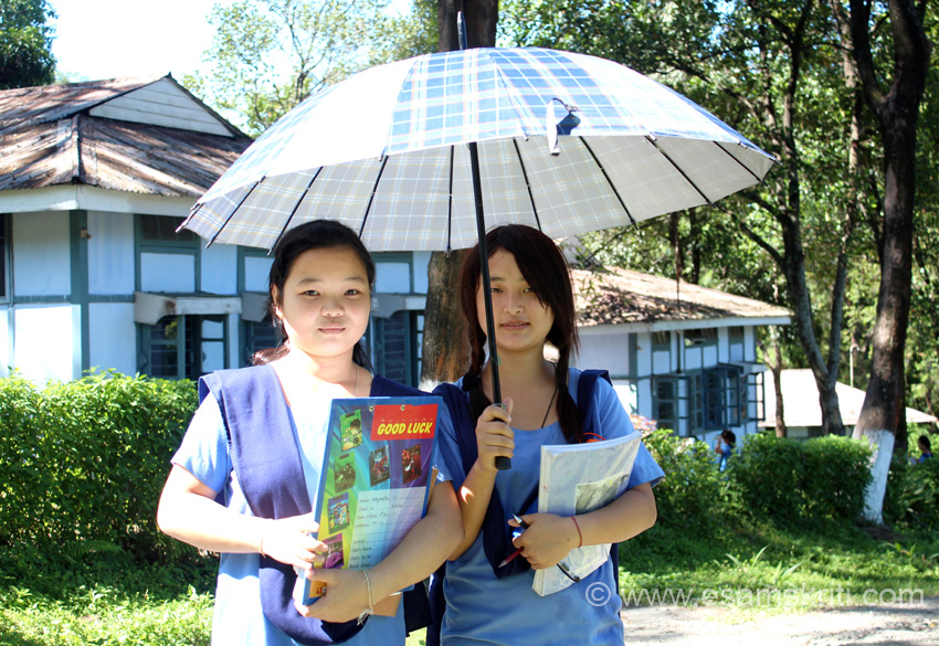 It was extremely sunny and humid in Sept. Some students use a umbrella even though it is a short walk from hostel to school. During the interactive session with students, the girl on the right asked ``since you worked with Hindustan Levers, which shampoo would you recommend``. I said Dove and Baba Ramadev``s Ayurvedic shampoo.