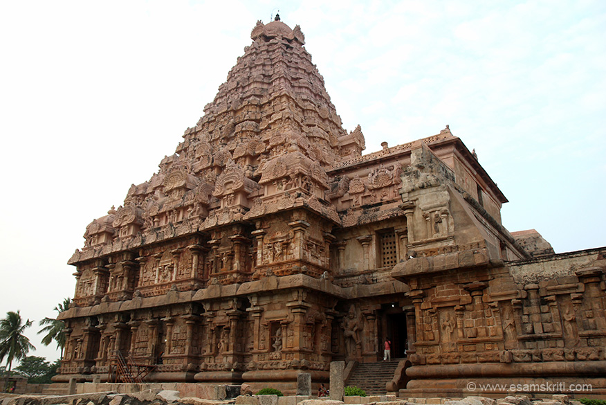 "We now present close ups of the lower part of structure and tower. This is a close up side view of tower. ""This Srivimana (tower) has 8 sided octagonal structure while the one at Tanjore is 4 sided. The basement of Srivimana is 100 feet by 100 feet, foundation square in structure that rises 20 feet above the ground."""