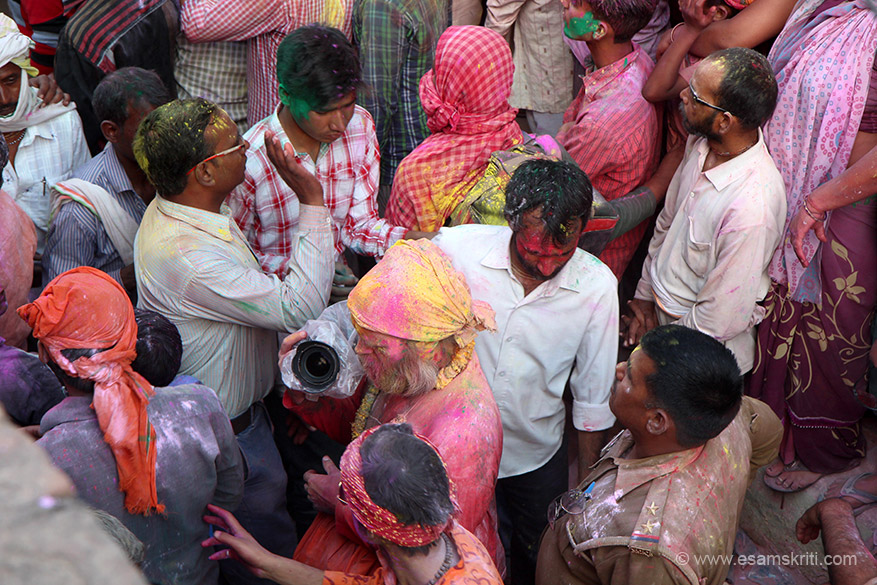 "Delhite or local, foreigner or Indian you had to look colorful as you see this tourist in pic. ""The tradition of playing colours on Holi draws its roots from Radha and Krishna. It is said that young Krishna was jealous of Radha's fair complexion since he himself was dark."""