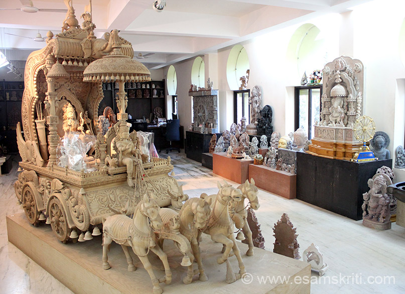 Wooden sculpted Krishna Arjun in Chariot in side show room of Sudarshan Art & Crafts Village.