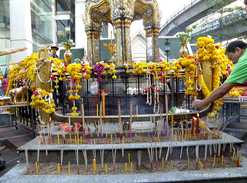 You can see incenses placed by devotees in front and flowers on the railing.