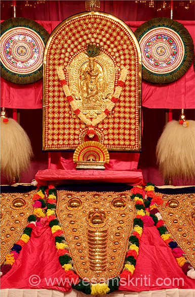 "Close up with image of Thidampu (deity) i.e. Sri Krishna in centre referred to in earlier caption. Round green color made of peacock feathers is called Aalavattam. Below that white hair like thing is called Venchamaram. To know more about Thiruvambady Temple <a href=""http://thrissurpooramfestival.com/thiruvambady_temple.html"" target=""_blank"">Click here</a>"