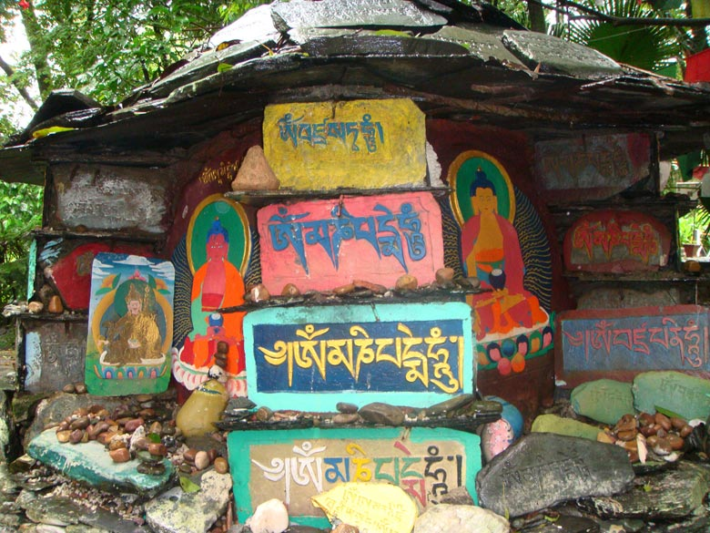 Colorful Tibetan inscriptions inside the Norbulingka monastery.