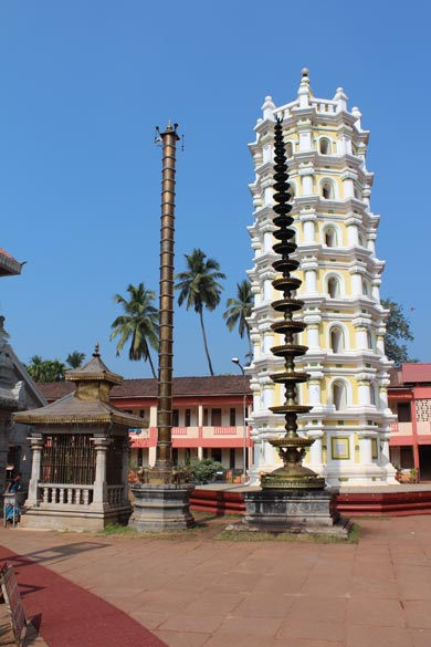 "Next is Mahalasha mandir ie Vishnu ka mohini roop. Left of pic gold color is  ""dwajasthambha"" - the flag post of the deity. During special festivals the flag of the deity is invvariably hoisted after