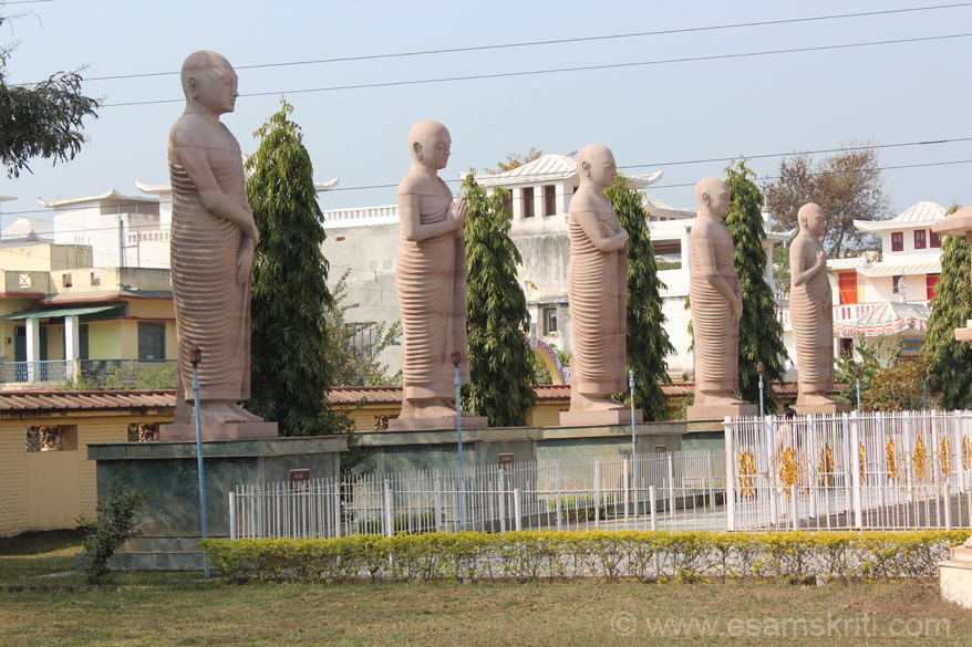 On either side of the image are statues of Buddha disciples. These images are on left of statue and represent Ananda, Sariputra, Punna, Mahakaccana and Rahula.