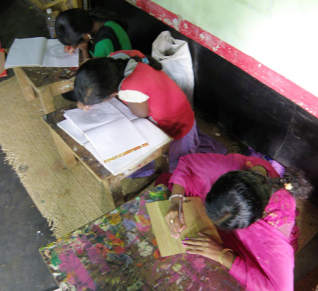 In one of the homes saw these young girls undergoing training. The first girl is doing palm leaf engraving while the other two are drawing. Every house that we saw had men and women working on some painting or handicraft. In most homes craftsperson introduced themselves as a State or National Award Winner. I got a complex and began to question my achievements in life.