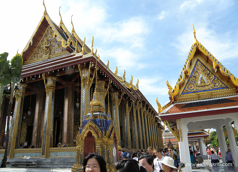Left of picture is the entrance to the monument that houses the Emerald Buddha. The Buddha is enshrined on a golden Thai- style throne made of gilded-carved wood, known as Busabok, in the ordination hall of the Royal Monastery. The Emerald Buddha is carved from a blockade of green jade and was first discovered in 1434 in a stupa in Chiang Rai. In Thailand always look at the top of the shrine, you will invariably find a Garuda. I made mistake of not seeing the image at entrance of Emerald Buddha.